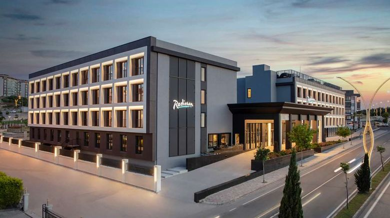 """Radisson Hotel Izmir Aliaga Exterior. Images powered by <a href=""""http://web.iceportal.com"""" target=""""_blank"""" rel=""""noopener"""">Ice Portal</a>."""