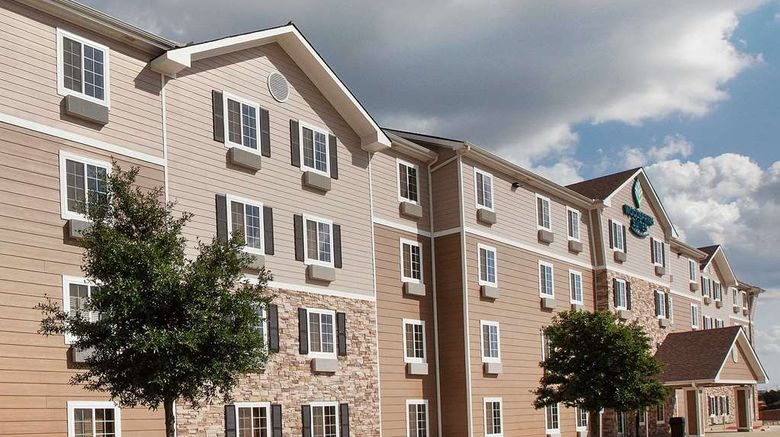 """WoodSpring Suites College Station Exterior. Images powered by <a href=""""http://web.iceportal.com"""" target=""""_blank"""" rel=""""noopener"""">Ice Portal</a>."""