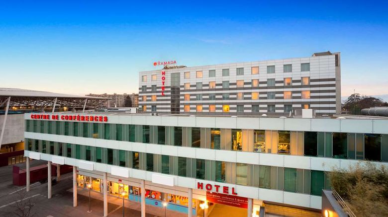 """Ramada Encore Geneva Exterior. Images powered by <a href=""""http://web.iceportal.com"""" target=""""_blank"""" rel=""""noopener"""">Ice Portal</a>."""
