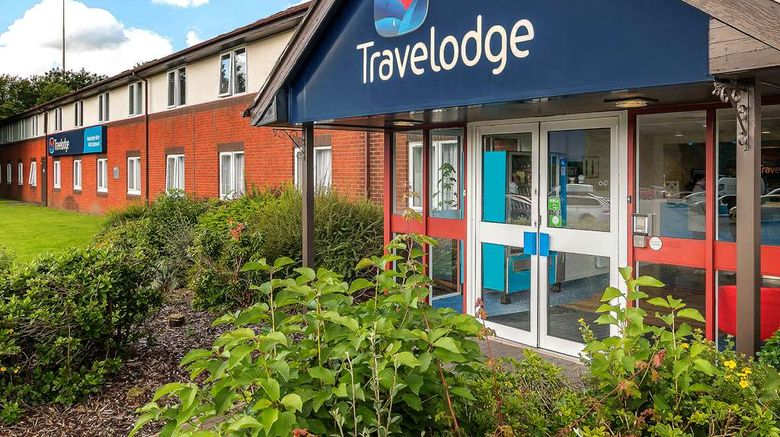 """Travelodge Manchester Birch M62 Eastboun Exterior. Images powered by <a href=""""http://web.iceportal.com"""" target=""""_blank"""" rel=""""noopener"""">Ice Portal</a>."""