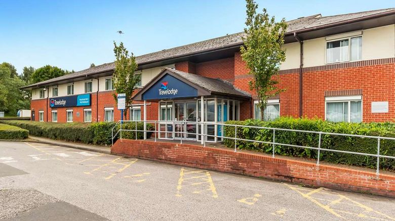 """Travelodge Manchester Birch M62 Westboun Exterior. Images powered by <a href=""""http://web.iceportal.com"""" target=""""_blank"""" rel=""""noopener"""">Ice Portal</a>."""