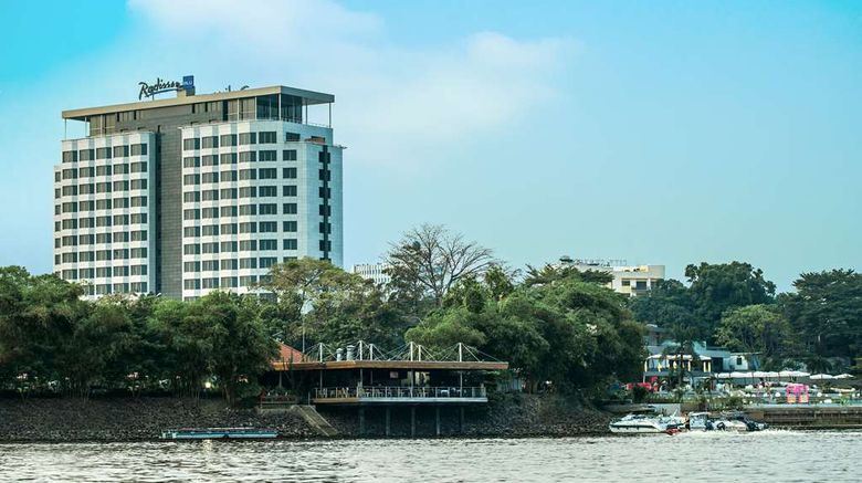 """Radisson Blu Mbamou Palace Hotel Exterior. Images powered by <a href=""""http://web.iceportal.com"""" target=""""_blank"""" rel=""""noopener"""">Ice Portal</a>."""