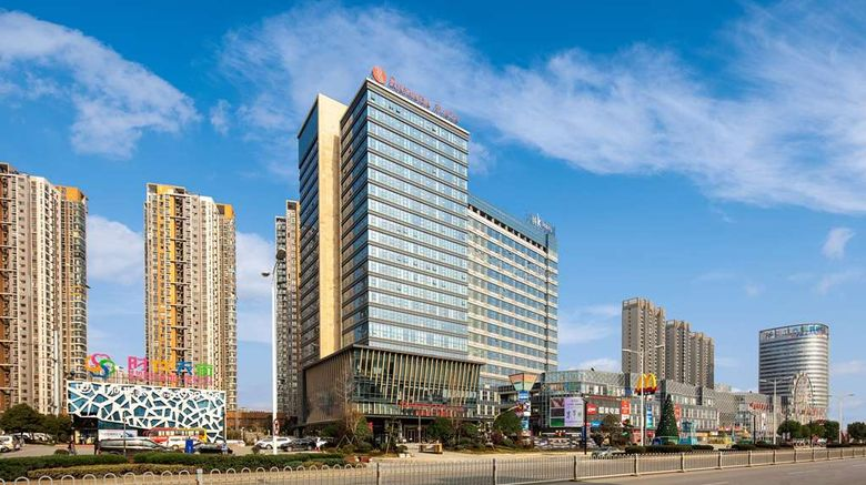 """Ramada Plaza Wyndham Xiangyang Exterior. Images powered by <a href=""""http://web.iceportal.com"""" target=""""_blank"""" rel=""""noopener"""">Ice Portal</a>."""