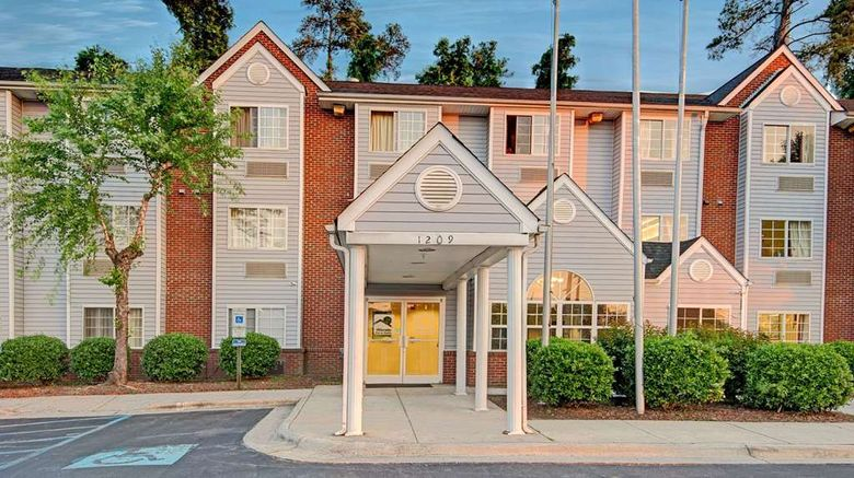 """Microtel Inn  and  Suites by Wyndham Raleigh Exterior. Images powered by <a href=""""http://web.iceportal.com"""" target=""""_blank"""" rel=""""noopener"""">Ice Portal</a>."""