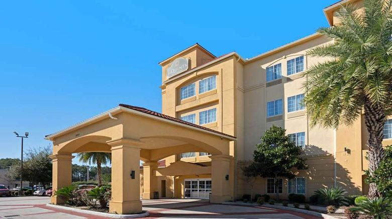 """La Quinta Inn  and  Suites Bush Intl Airport Exterior. Images powered by <a href=""""http://web.iceportal.com"""" target=""""_blank"""" rel=""""noopener"""">Ice Portal</a>."""
