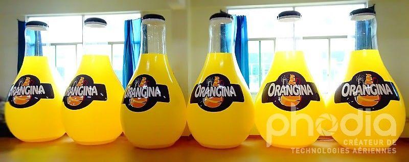 bouteille orangina 3m géante transparente imprimée avec logo gonflable pour communication