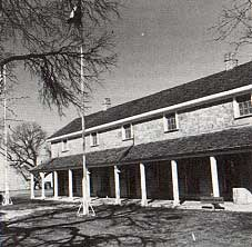 Photo of the headquarters building which contains a military museum. Taken by Charles M. Robinson, III from the book, Frontier Forts of Texas
