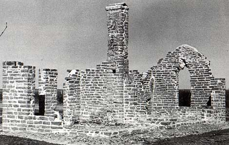 Photo of ruins of the headquarters building taken by Charles M. Robinson, III from the book, Frontier Forts of Texas