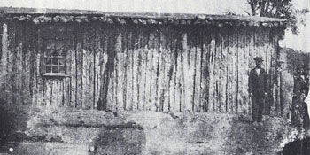 Picture of Dutch Nance Standing at his Cabin with a Tonkawa Indian Scount