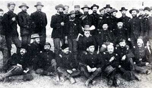 Picture of Officers of the 6th Cavalry who fought at Wounded Knee, including John J. Pershing, standing at right center.