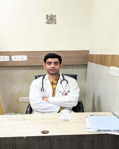 Dr. Ramit Singh Sambyal in his white Knee Length overcoat in Vasant Kunj, Delhi