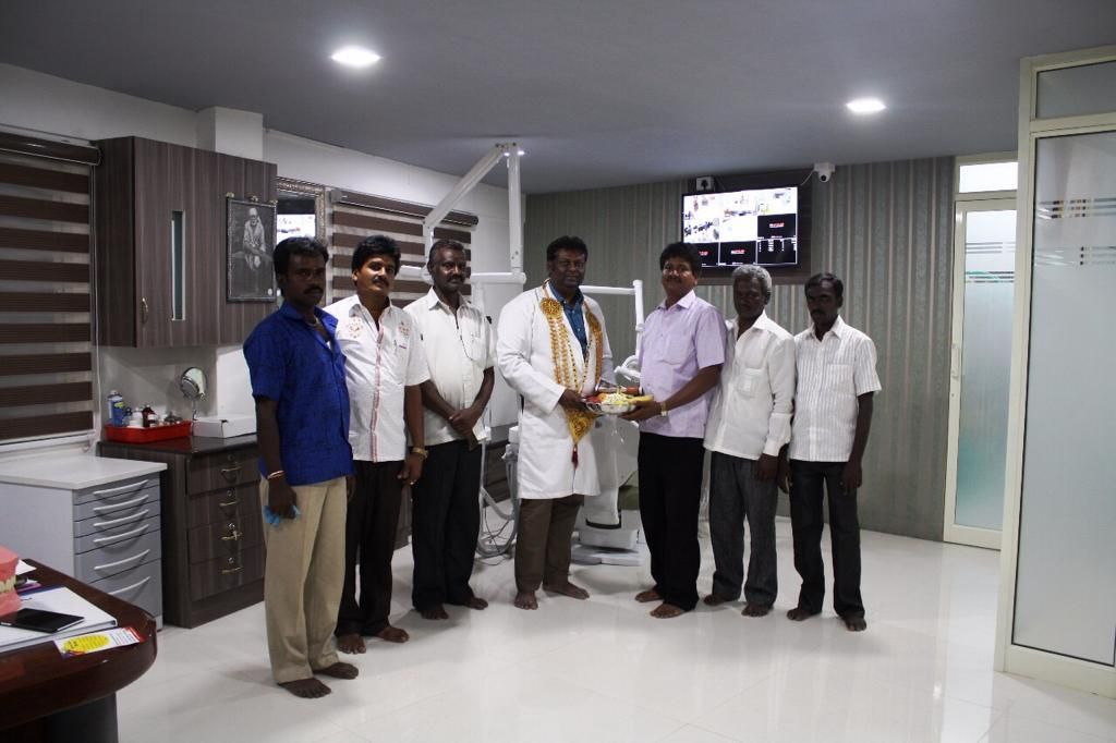 Dr. Ganesh Vaiyapuri being honored by the community at his dental hospital in Chennai