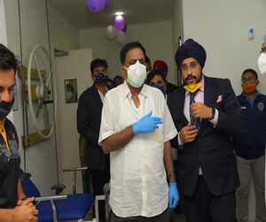 Dr Sandeep Singh talking with Naba Kishore Das, health and family welfare minister, Bhubaneswar