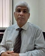 Dr. Kishore Manek