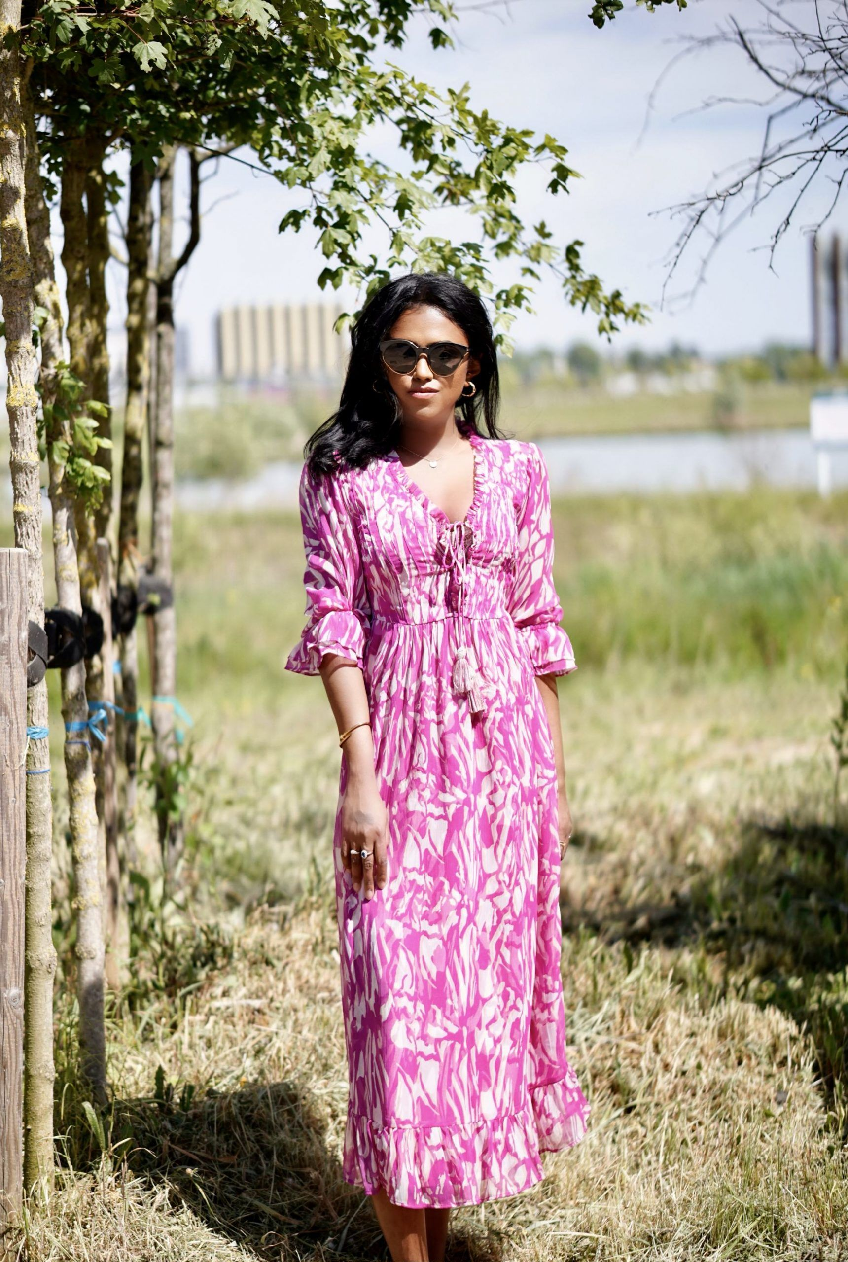 Sachini in the nature wearing a white and pink dress