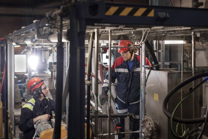 Erik Niva and Rickard Jolsterå, Senior Research Engineers at LKAB, in the pilot plant next to the classifier and magnetic separator.