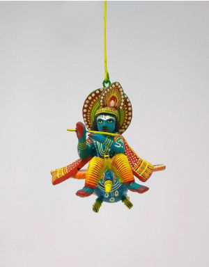 Colorful wooden Shri Krishna on Peacock