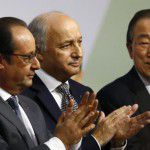 "French President Francois Hollande, left, French foreign minister Laurent Fabius, center, and United Nations Secretary General Ban Ki-moon applaud at the COP21, the United Nations Climate Change Conference, in Le Bourget, north of Paris, Saturday, Dec.12, 2015. Fabius says a ""final"" draft of a global climate pact would be legally binding. (AP Photo/Francois Mori)"