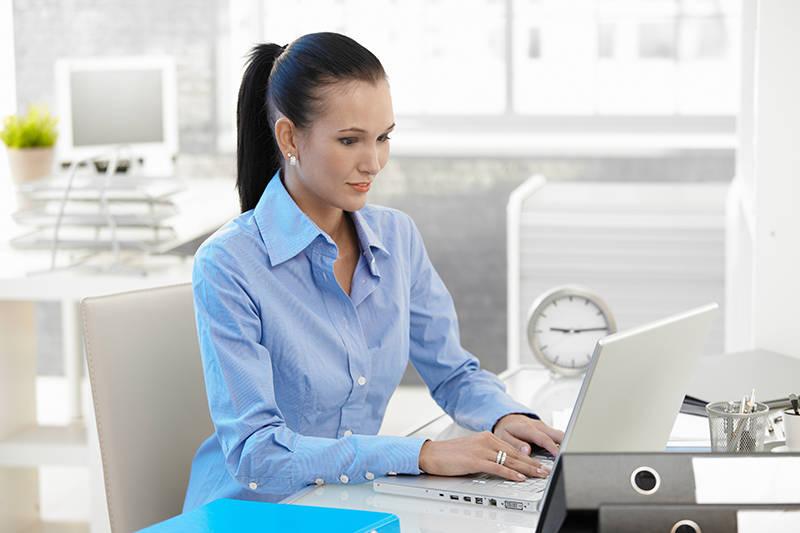 Office girl blog writing on laptop