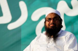 """Hafiz Muhammad Saeed, chief of the banned Islamic charity Jamat-ud-Dawa, looks over the crowed as they end a """"Kashmir Caravan"""" from Lahore with a protest in Islamabad, Pakistan July 20, 2016. REUTERS/Caren Firouz/Files"""