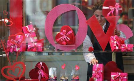 f559e129aaf A vendor adjusts decorative red hearts and praline boxes behind the window  of a Belgian chocolate shop ahead of Valentine s Day in Brussels February  13
