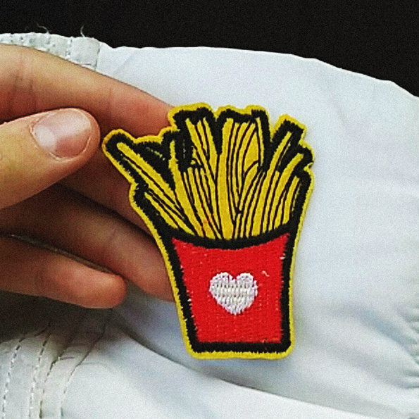Fries embroidered patch iron-on in hand