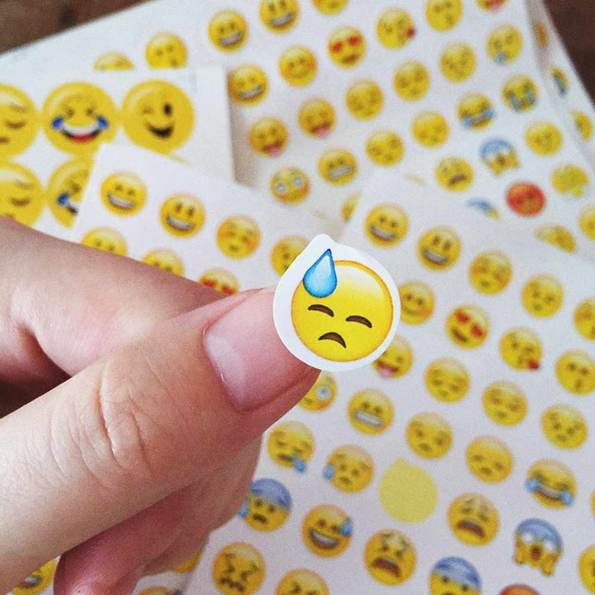 Emoji sticker finger close-up