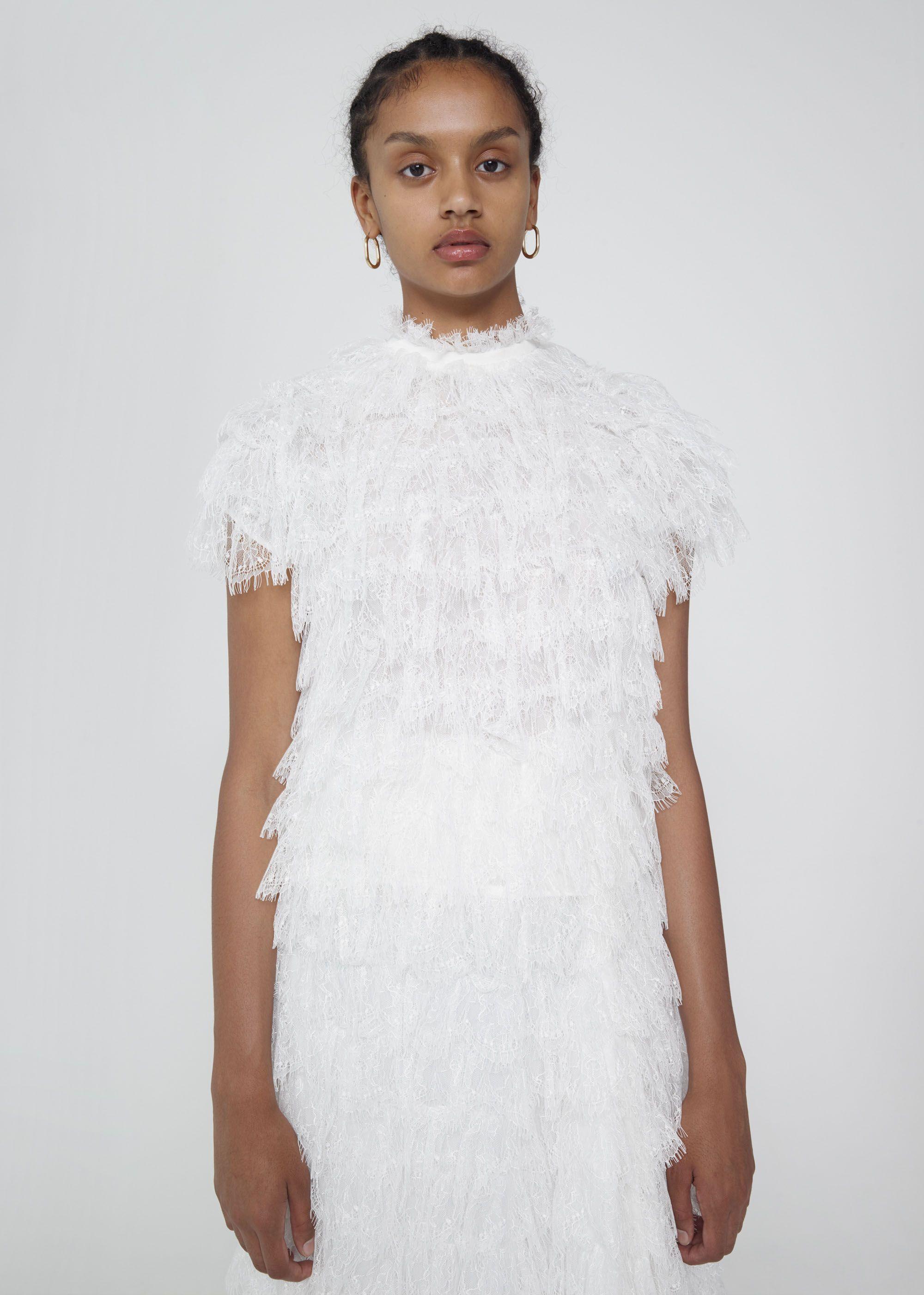 white fullruffle blouse