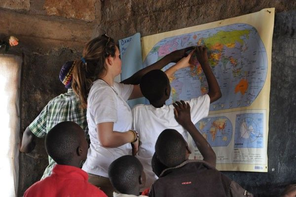 Oakham students fixing desks on school trips to Africa