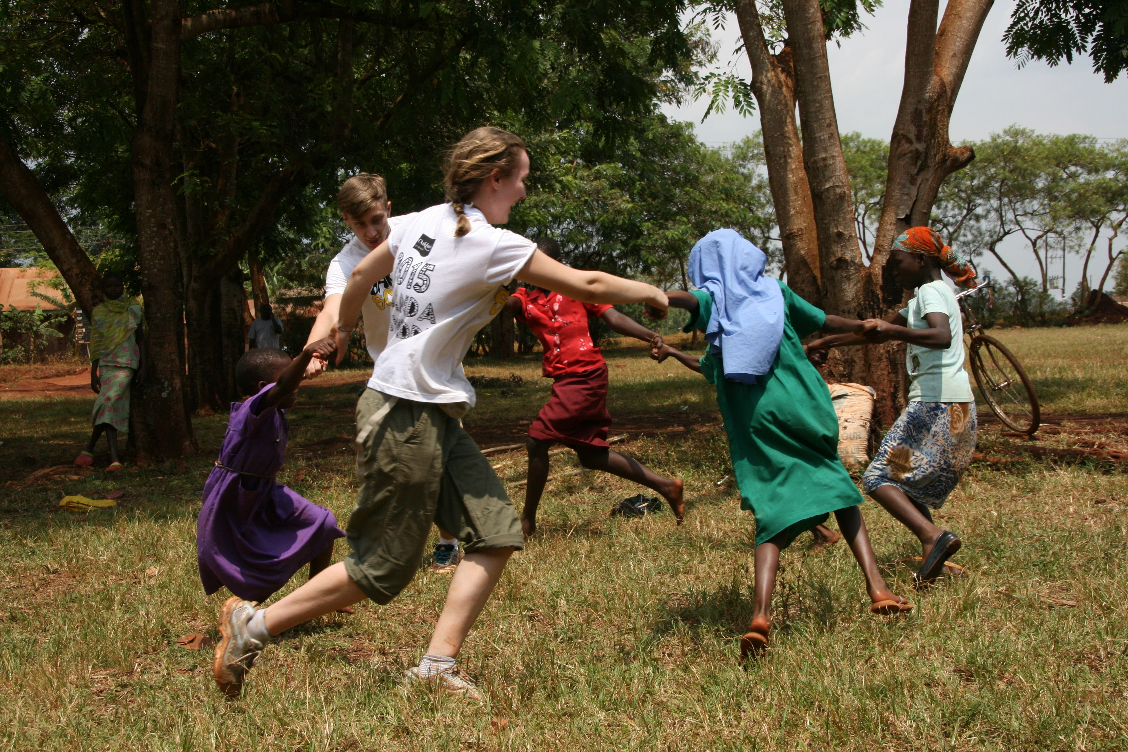 Oakham students dancing with the children on their School Trips to Africa