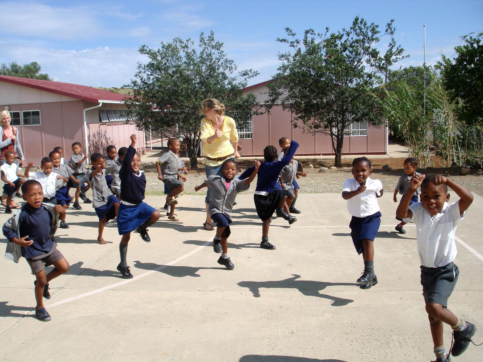 AV volunteer playing with children in South Africa