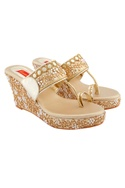 Gold wedges with embellishments