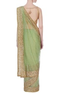 Green net sari with blouse-piece & petticoat