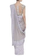 Sequin & pearl embroidered border sari with unstitched blouse fabric.