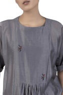 Asymmetric tunic with flower detail