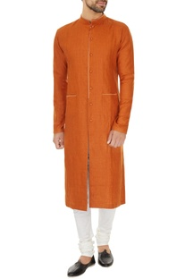 Orange linen solid kurta with off white cotton lycra churidar