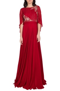 Embellished gown with draped sleeves