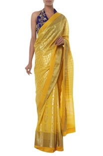 Printed sari with embroidered halter blouse