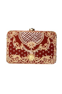 Rust embroidered clutch