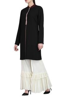 Black embroidered tunic & ivory ruffle pants