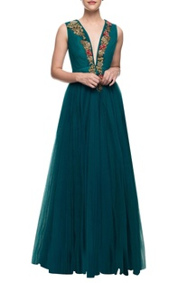 Teal floor length gown with floral embroidery on the yoke.