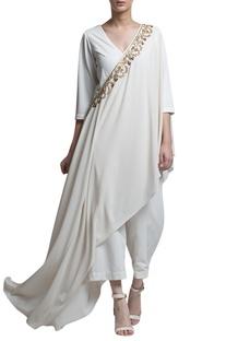 Ivory jumpsuit with drape
