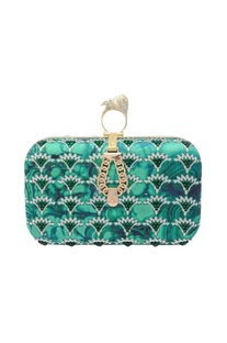 Green clutch with abstract print