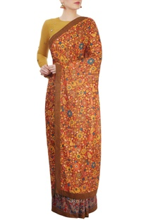 Multi colored printed sari with ochre blouse