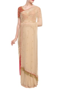 Beige sari with red embellished blouse
