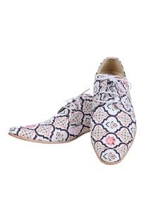 White geometric print shoes