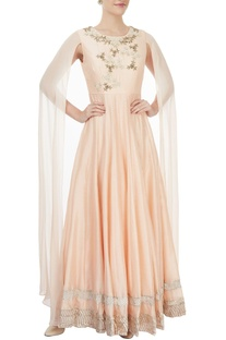 Beige gown with dramatic sleeves