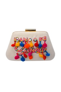 White clutch with colourful embroidered text