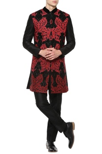Red sherwani with black trousers