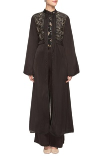 Black trousers with printed top and jacket.